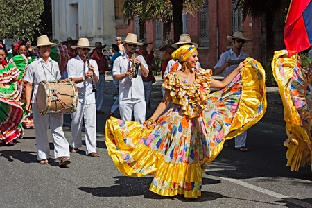 street parade of ensemble Jocaycu from Colombia - colombian dancers in traditional dress performs popular dance during the International folk festival on August 5, 2012 in Russi, Ravenna, Italy