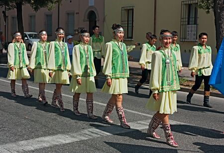 street parade of the folklore ensemble AAR-AARTYK from Yakutia, Russia- russian dancers in traditional dress at International folk festival on August 5, 2012 in Russi, Ravenna, Italy