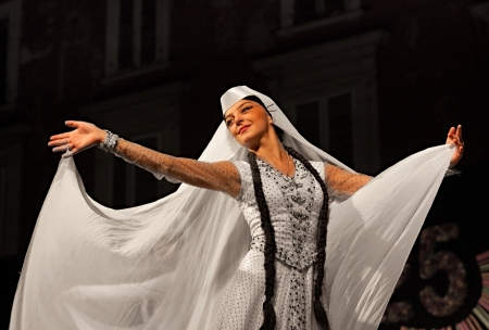 girl of ensemble Khorumi from Georgia performs elegant traditional dance - georgian dancer in typical dress whit veil at International folk festival on August 5, 2012 in Russi, Ravenna, Italy