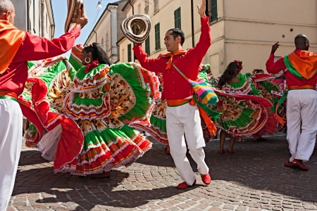 vaulting: ensemble Jocaycu from Colombia - colombian dancers in traditional dress performs popular dance at International folk festival on August 5, 2012 in Russi, Ravenna, Italy