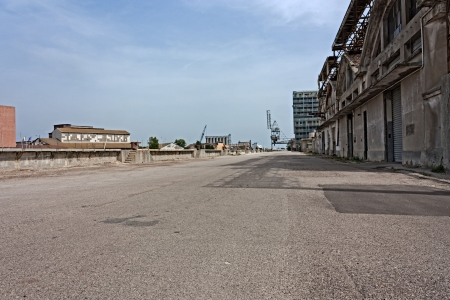 deprived: desolated street on the docks of port - desert suburbs of the city with abandoned warehouses and factories