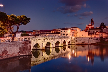 the ancient roman bridge of Tiberius at dusk in Rimini, historic landmark of Italy