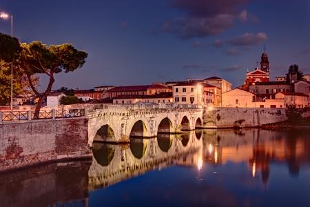 emilia romagna: the ancient roman bridge of Tiberius at dusk in Rimini, historic landmark of Italy