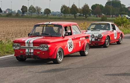 reenactment re enactment: vintage racing car NSU TTS(1968) and Porsche 911 2.0 L Rallye (1965) in rally Gran Premio Nuvolari 2012, endurance race for classic cars, on September 23, 2012 in Classe(Ravenna) Italy Editorial