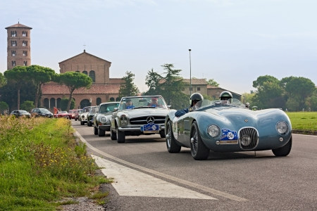 reenactment re enactment: vintage racing car Jaguar C-TYPE (1968), Mercedes Benz 280 SL8 (1969) and other cars in front of the famous Basilica of Sant Editorial