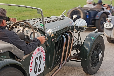 an old racing car Jaguar SS100 Spec. (1938) runs in rally Gran Premio Nuvolari 2012, endurance race for classic cars, on September 23, 2012 in Classe (Ravenna) Italy