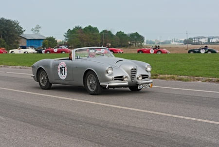 regularity: a vintage car Alfa Romeo 1900 CSS Zagato spider (1957) runs in rally Gran Premio Nuvolari 2012, endurance race for classic cars, on September 23, 2012 in Classe(Ravenna) Italy
