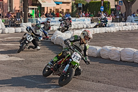 riders racing at 'II trofeo Lusa Moto' for pit bike motard during the motorcycle festival 'Rombi di passione' on october 6, 2012 in Lugo, RA, Italy