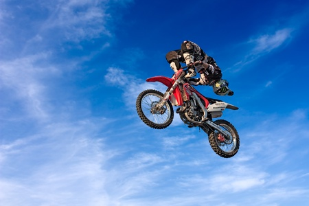 a stunt biker make an acrobatic jump at the trial and motocross freestyle show Monster Pirate Troop during the motorcycle festival Rombi di passione on october 6, 2012 in Lugo, RA, Italy