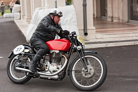 motosport: biker riding a vintage italian motorcycle Gilera at motorcycle festival  Rombi di passione  on september 30, 2012 in Lugo, RA, Italy