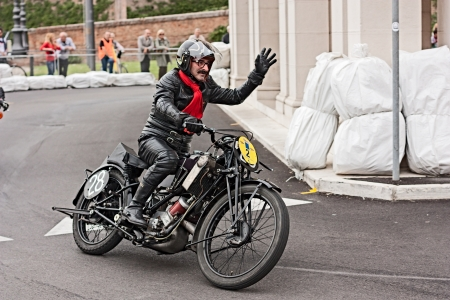 ra: biker riding an old racing motorcycle Scott TT at motorcycle festival  Rombi di passione  on september 30, 2012 in Lugo, RA, Italy