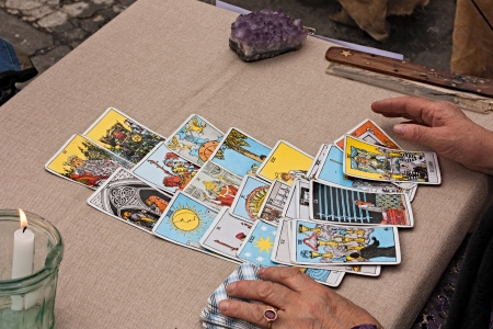 a woman reading tarots cards at festival Fiera di San Rocco on November 4, 2012 in Faenza, RA, Italy.  Editorial