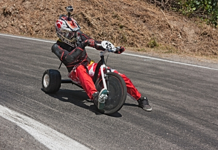 huffy: PREDAPIO ALTA, ITALY - JULY 28: unidentified driver on  exhibition of trike slide during the european championship speed down on July 28, 2012 in Predappio Alta, FC, Italy