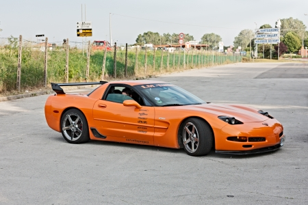 ra: a sports car Chevrolet Corvette at rally Corvette on the beach on May 12, 2012 in Cervia (RA) Italy