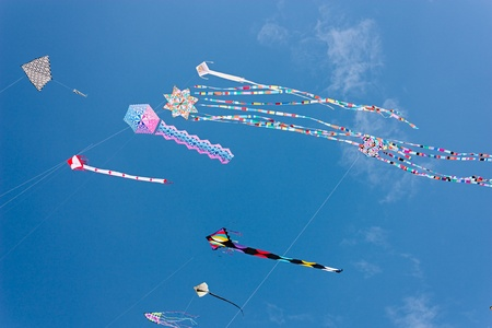 ra: artistic and colorful kites in the blue sky at international kite festival, on April 30, 2012 in Cervia (RA) Italy  Editorial