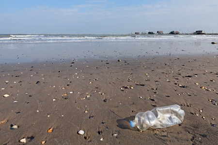 plastic bottle litter on the beach - landscape of seaside with fishing hut on background Stock Photo - 18088003