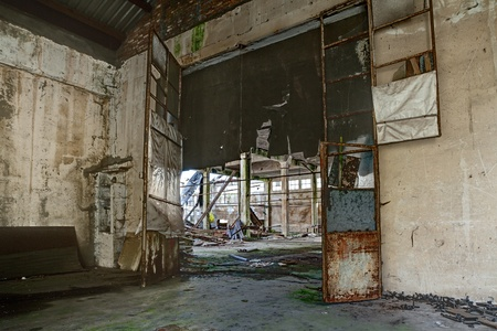 interior of an old abandoned factory with rubble and debris - ruins of an ancient industrial building - hdr image Editorial