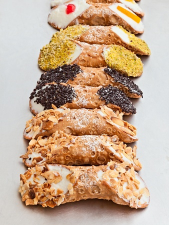 cannoli pastry: italian cannoli, a traditional sicilian dessert made with fried pastry dough filled with creamy, ricotta, almond, chocolate, fruit, candy