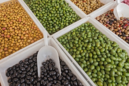 brine: assortment of olives salted, preserved in brine or pickle, in italian market Stock Photo