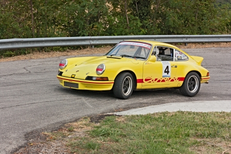 swerve: vintage Porsche 911 T in hairpin bend at uphill race rally Predappio legend 2012, historical italian uphill race, on July 21, 2012 in Predappio, FC, Italy Editorial