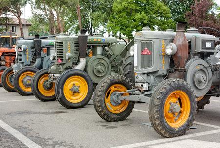vincoli: old italian tractors Landini hot bulb engine exhibit at Festa del 1 maggio on April 30 in San Pietro in Vincoli (RA) Italy.