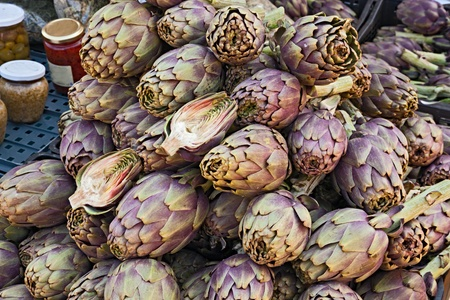 cardunculus scolymus: heap of artichokes in italian store fruit and vegetables - artichoke, an healthy ingredient of mediterranean diet