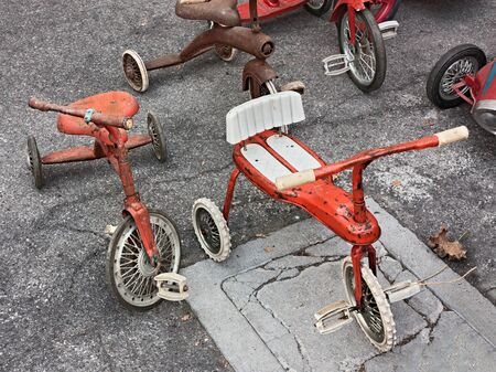 antique tricycle: vintage toys, old tricycles for children Stock Photo