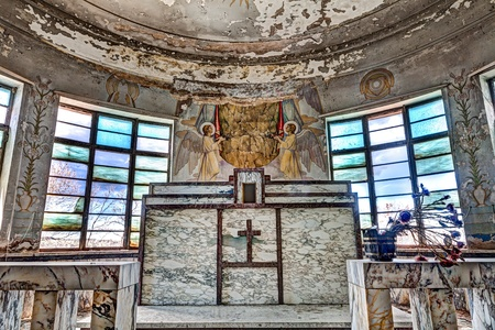 catholic chapel: marble altar of an old abandoned catholic church - ancient italian catholic chapel with frescoes and wall glass Editorial