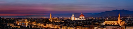 Florence landscape at sunset  - panoramic view of the famous Ponte Vecchio, the antique bridge on the Arno river, cathedral, dome and Palazzo Vecchio