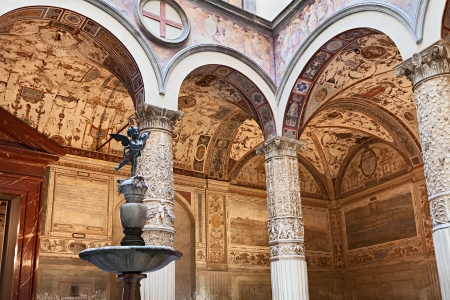 putto: interior of Palazzo Vecchio  Old Palace , in Florence, Italy, with antique frescoes and the fountain with the statue of the putto with dolphin