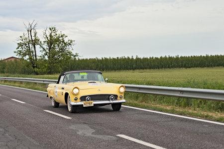thunderbird: a vintage american car Ford Thunderbird (1955) runs in rally Mille Miglia 2013, the famous italian historical race (1927-1957) on May 17, 2013 in Ravenna, Italy