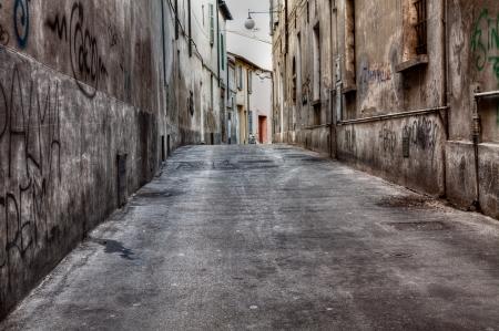 grunge dark alley - dirty city street - italian distressed old town - urban decay