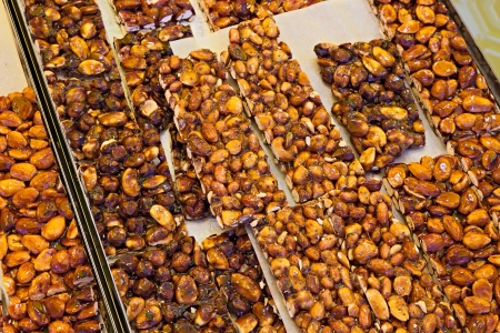 brittle: chunks of italian brittle nut, a traditional sweet snack made with caramel, almonds and hazelnuts Stock Photo