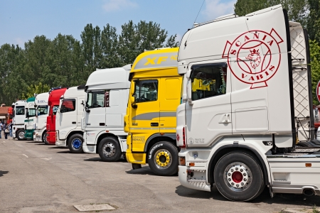 shiny tractor trailer trucks parked during the truck rally Rombo Rock on June 1, 2013 in Riolo Terme, RA, Italy