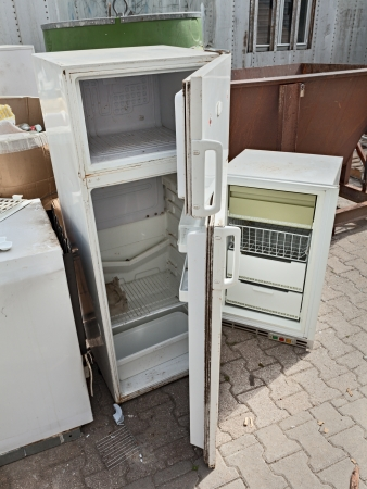pile reuse: hazardous waste - fridges dump, broken fridge containing cfc, danger to the ozone  Stock Photo