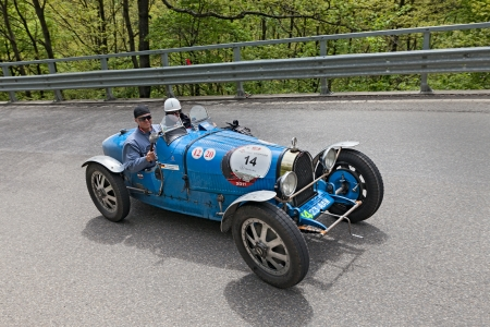 miles: an old racing car Bugatti T 35 T (1926) runs in rally Mille Miglia 2013, the famous italian historical race (1927-1957) on May 18, 2013 in Passo della Futa (FI) Italy