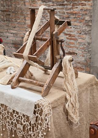 hand woven: old winder machine with hank of hemp fiber - antique tool for making hemp fabric