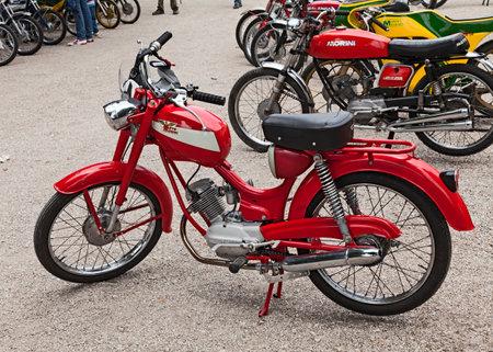 economic revival: old italian moped Moto Morini Corsarino 50 4t Donna exposed at the motor festival Festa de mutor on June 9, 2013 in Pezzolo di Russi, RA, Italy Editorial