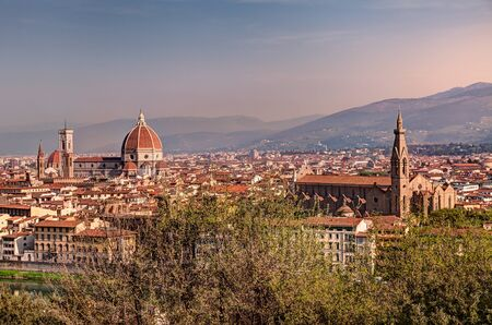 panorama at dawn of Florence, Italy  - cityscape at sunrise, view of the famous cathedral Santa Maria del Fiore and church of Santa Croce photo