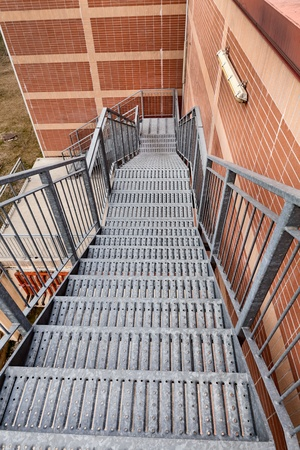 Fire escape ladder - metal stairs on the side of a building  photo