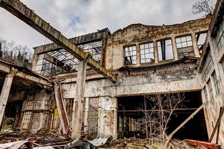 industrial ruins: old abandoned and collapsed factory with rubble and debris - ruins of an ancient industrial building - hdr image