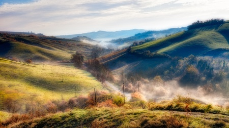 emilia romagna: early morning on the hills of Emilia Romagna, Italy - italian landscape at dawn with fog in the valley