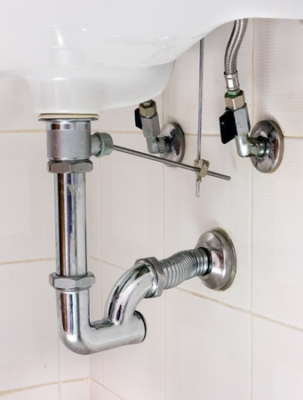 basin drainer - siphon with p-trap and insert for pop up waste Stock Photo