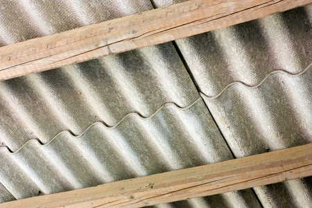 asbestos cement panels - wavy roof cover on pollutant eternit  panels Stock Photo