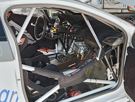 tuned: interior of a racing car Peugeot 207, winner of the competition Rally della Romagna 2013, with roll cage and tuned controls and dashboard, on July 27, 2013 in Castrocaro, FC, Italy
