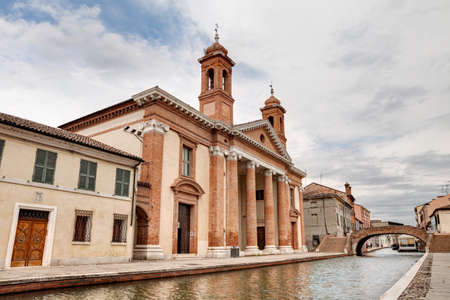 camillo: catholic church of San Camillo near at the canal and an antique arch bridge in Comacchio, Ferrara, Italy