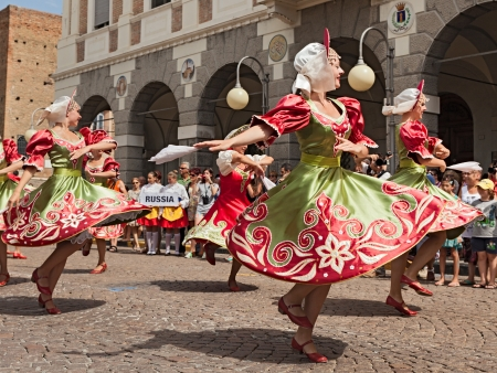 russian federation: the ensemble Metelitsa from Novosibirsk, Russia, performs folk dances during the International Folklore Festival of Russi on AUGUST 2, 2009 in Russi, Ravenna, Italy
