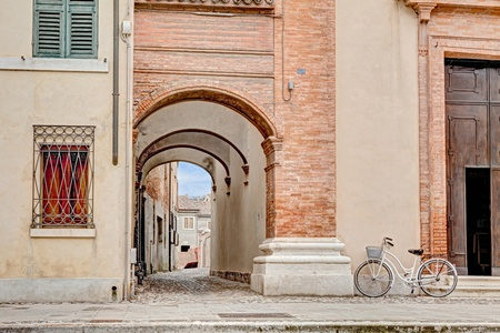 narrow alley with archway in Comacchio, Ferrara, Italy photo