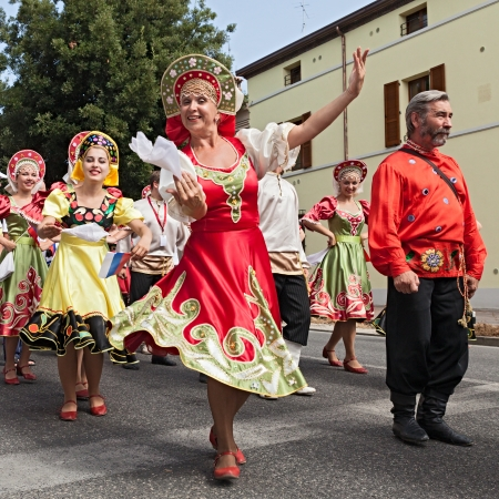 russian federation: street parade of folk ensemble the ensemble Metelitsa from Novosibirsk, Russia, performs folk dances during the International Folklore Festival of Russi on AUGUST 2, 2009 in Russi, Ravenna, Italy