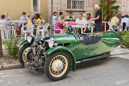 three wheeler: a british three wheeler car Morgan MX4  1934  at rally  motoraduno d